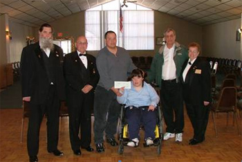Pictured from left to right:: Richard Billings Lodge Special Needs Chairman, Donald E. Cunningham State Trustee, Richard Castaldi Father, Recipient Jennifer Redman,  Louis Provost Rhode Island State Elks President, Celeste M. Cunningham West Warwick Elks Lodge #1697 President.<BR><BR><b>Special Needs member presented a check for $8,200 to Jennifer for her  special van lift chair.</b>