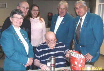 Veterans Committee Members Dianne Meyer, George Love, Michelle Dougherty, Gerry Elman & Norm Lazore spend some time with a local Nursing Home Veteran at Christmas time.  31 Veterans were visited and presented with a small Christmas present and some great company.