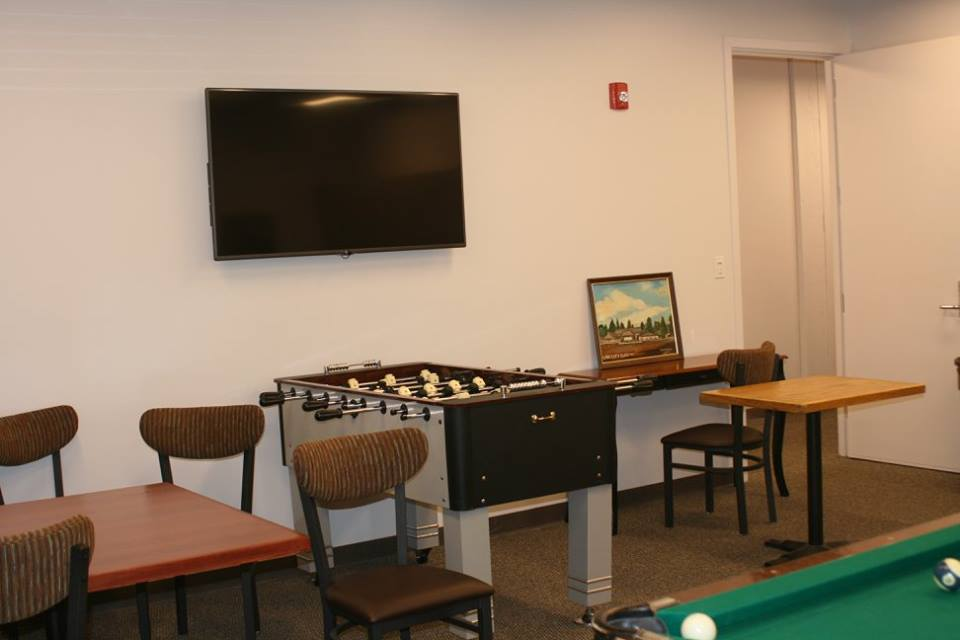 Our gameroom with pool, foos ball and TV.