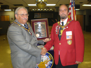 Presenting the plaque to the Exalted Ruler.