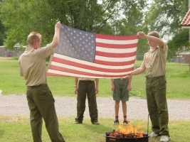 The Boy Scouts showing the proper way to retire the colors when they are tattered and worn. This is presenting the colors.