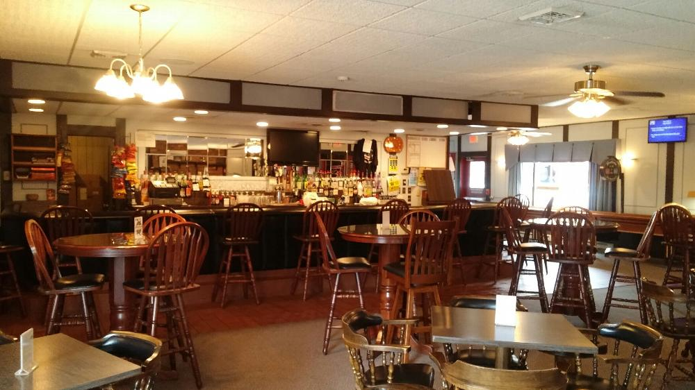 Lounge has 10 tables, three TVs and a shuffleboard table.