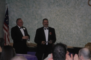 PER Wayne Pynckels presents the 2009 Officer of the Year Award to ER-Elect Angelo Golino, Jr.