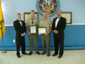 Eagle Scout Anthony Higgins accepts Awards From Sussex Lodge #2288 From left to right: Leading Knight Tim Doyle, Eagle Scout Anthony Higgins, Scout Master and Member Rich Flynn, Exalted Ruler Steve Clark
