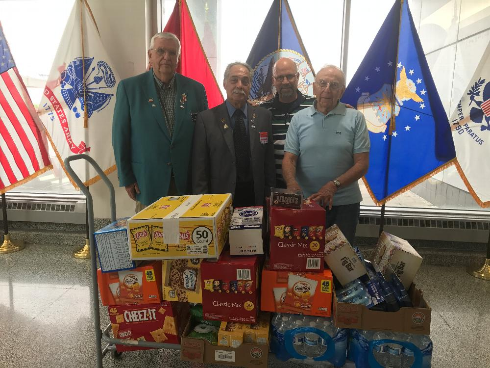 Treasurer Bob McIntyre, PDDGER Rocco Arcaro, and Veterans' Affairs Chairman Bob Maraio deliver supplies to the Harrison Courtsey Room at the Syracuse International Airport. Supplies are intended to comfort active duty military personnel as they travel through the airport. (2019)