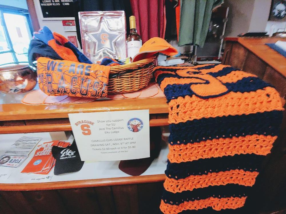 Show your  SU colors and support your Lodge Raffle. SU paraphernalia and a hand crocheted  afghan were raffled to aid our maintenance fund. Items were generous gifts from Lodge members (11/29/19)