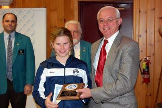 West Genesee student 9 year old Anna Snyder receiving her award from Past State President Don at the 2012 New York State Hoop Shoot Contest in Glens Falls, NY.  Anna came in fourth place in the state.
