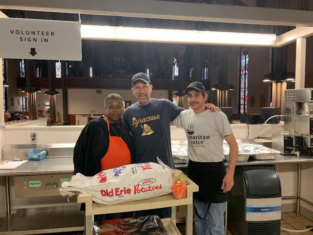 PER Jay Mason delivers 50 BBQed chicken halves and salads to the Samaritan Center in Syracuse, NY