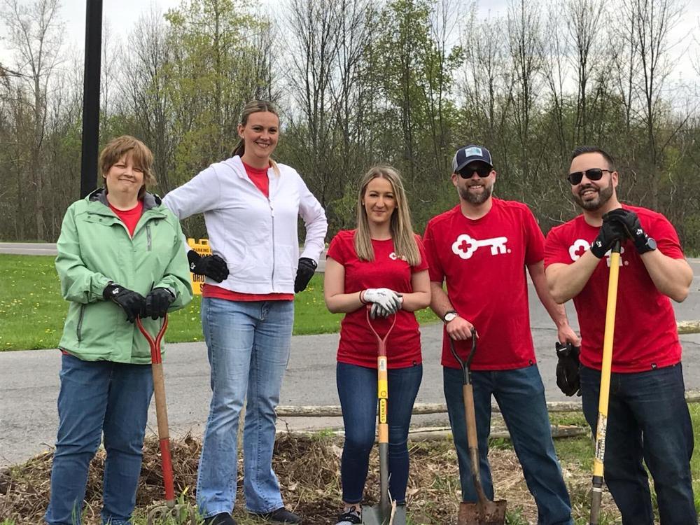 """Employees of Key Bank's Fairmount office assist with gardening duties at the Lodge during Their """"Neighbors Make a Difference Day"""". Spring 2019"""