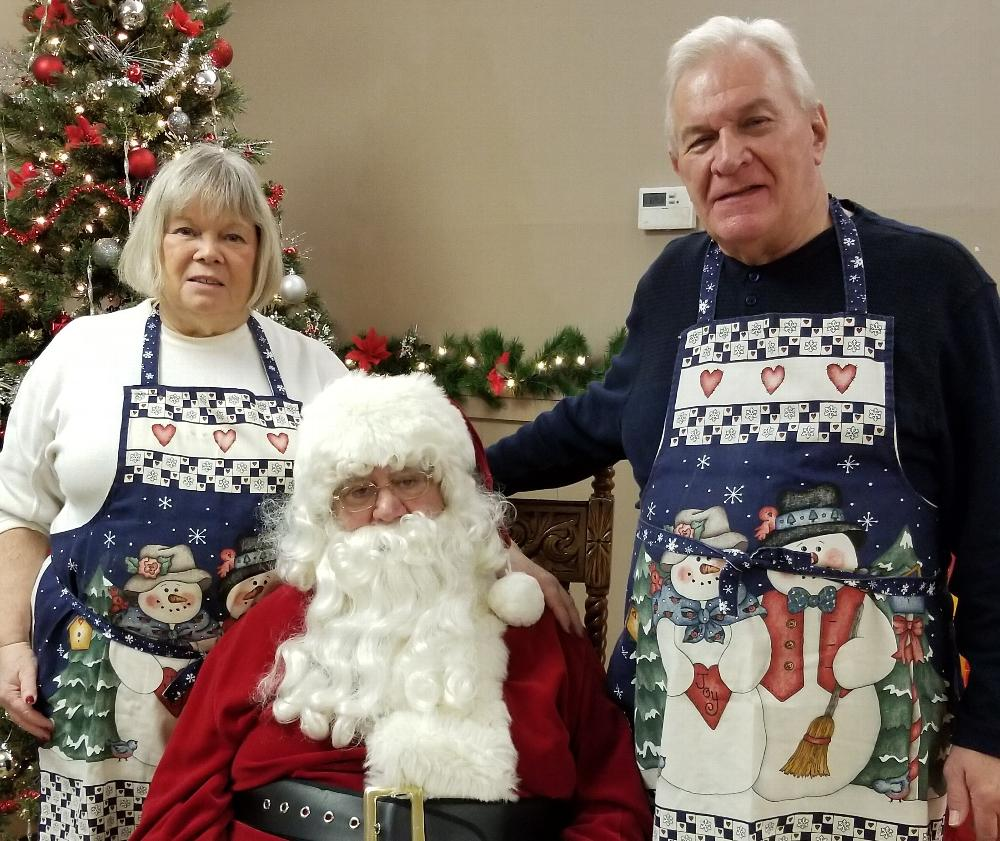 December 2018 - Members Stan and Cheryl Chesneski are shown with Santa during breakfast with Santa. In addition to an excellent breakfast, children have an opportunity to tell Santa what they want for Christmas and receive a small gift. 12/18