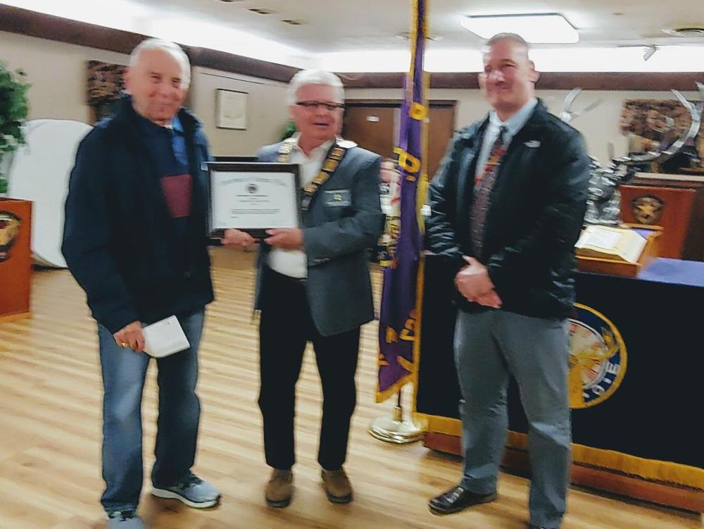 Dennis Fogg (right) Director of Volunteer Services at The Syracuse Veterans Administration Hospital presents a Certificate of Appreciation to Camillus Elks Lodge ER Jim Roe (center) and Lodge Veterans Affairs Director Bob Mario for the support our Lodge provides to enhance the comfort of th hospital's residents. (10/25/19)