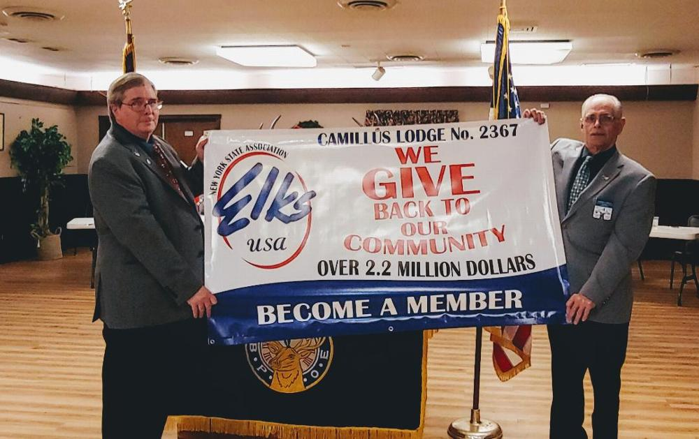 December 9, 2019 State Vice President Bob Culican and DDGER Ray Caplin present a banner acknowledging  the Camillus Elks Lodge for given back more than $2.2 million to the community. Also, our Lodge was recognized for have a deliquency rate of 1.2% - the lowest in the state.