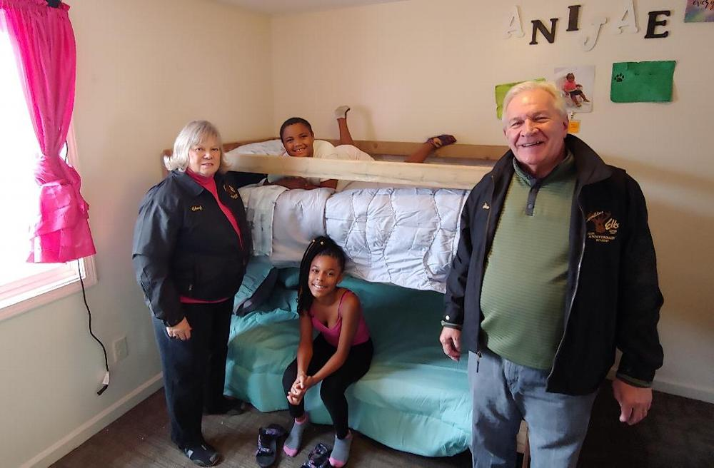 Lodge Trustee Stan Chesneski and Secretary Cheryl Chesneski participate in delivering bunk beds that were built by Lodge members and volunteers in conjunction with Sleep in Heavenly Peace. The looks on the children's faces was all the thanks anyone would need.(11/2/19)