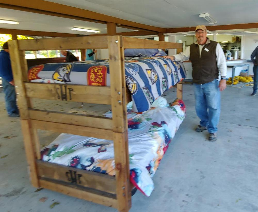 """Lodge Member Steve Knowles stands beside a completed bunk bed. The Camillus Elks Lodge #2357 joined forces with Sleep in Heavenly Peace on October 13, 2019 to build bunk beds for children who might otherwise sleep on the floor. Sleep in Heavenly Peace's motto is """"No kid sleeps on the floor in our town"""". We were able to purchase supplies with a $2,500 grant provided by Elks National Foundation. (10/13/19)"""