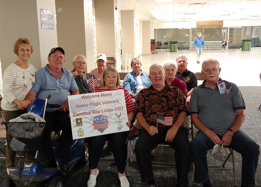 A group of Lodge members  await the arrival of veterans from their Honor Flight to Washington D.C. (September 2019)