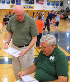 Member Larry Hammondtree and Lodge Inner Guard Bob McIntyre collect score sheets at the 2011-2012 Lodge Hoop Shoot contest.