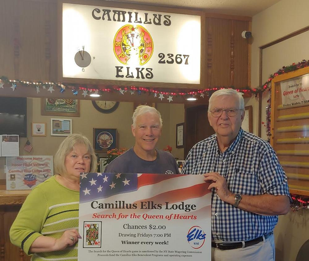 Secretary Cheryl Chesneski and Treasurer Bob McIntyre (right) are joined by the winner of a recent Queen of Hearts jackpot. (2019)