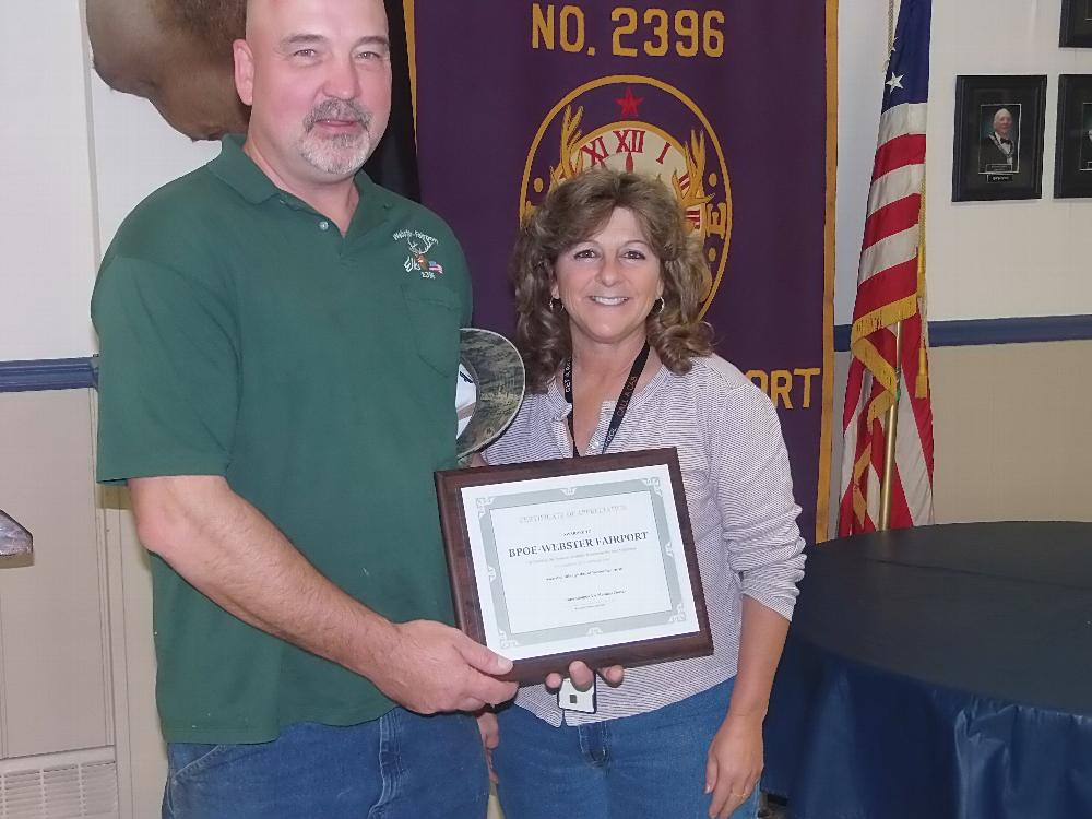 PER Bob Snover accepts recognition certificate from Lucy Olsen, VA Coordinator, for the Webster-Fairport Elks service to the VA Hospital