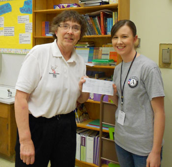 Leading Knight presents Amy Reed of Joseph Gale Elementary with check for $572.00 for Backpack Nutrition program.