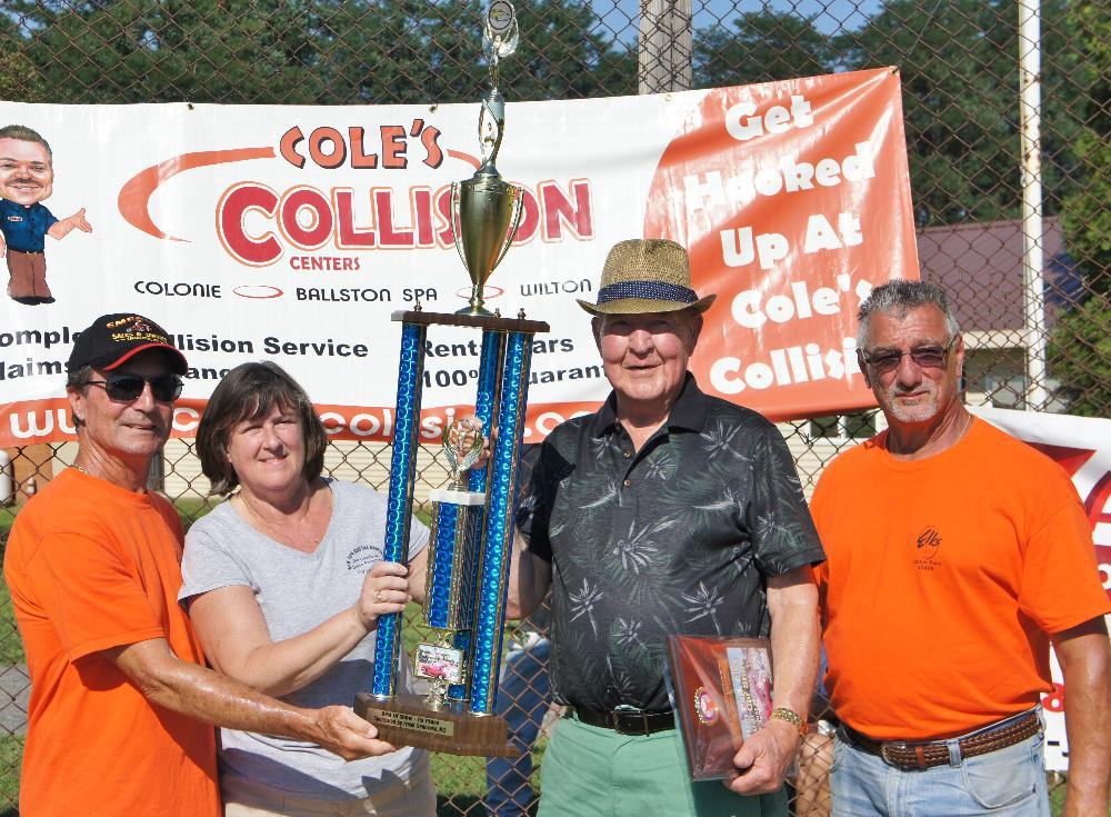 Dick Campion, ER Audrey Osterlitz, and Mike Bendetti award the First Place Trophy at the 2016 Car Show on August 20. The event was highly successful with over 150 vehicles registered.