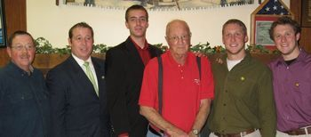 Grandfather in red shirt with 4 of his grand children as new members. (his son's a member to - far left.)