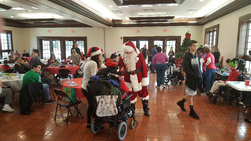 Santa visiting our special children at the Christmas party on 12-4-16