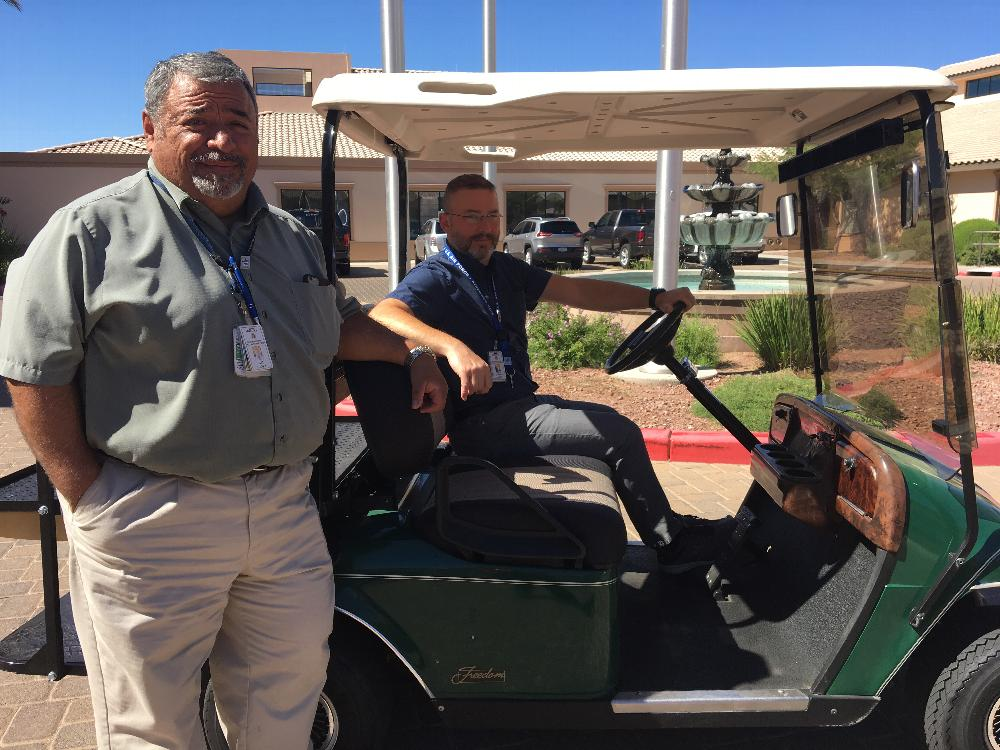 Sam Nanez and Ed Lloyd try out transportation golf cart donated by Tucson East to the Arizona State Veteran Home-Tucson.