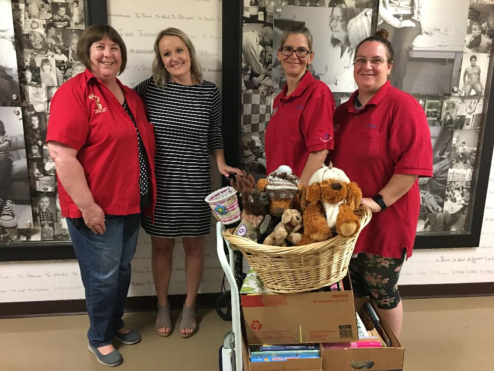 Donations of books and stuffed animals to the  UA Steele Children's Research Center.