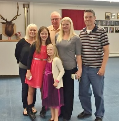 An Oct. 3, 2015 spaghetti dinner at the Sebasticook Valley Lodge raised $2,467 for the Kaylee Jarvis family to help with the youngster's medical expenses. In addition, a $500 donation from the Modern Woodmen Fund was presented to the family. Pictured, from left, are Dawn-Anne McMann, Kaylee's grandmother; Kaylee Jarvis; Roger McMann, Kaylee's grandmother; Angela Jarvis, Kaylee's mother; and Exalted Ruler Mike Lange. Front: Kaylee's younger sister, Ashlee.