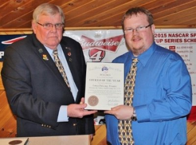 Trustee Lucas DeLong, right, was honored as 2015-16 Officer of the Year by Exalted Ruler Dennis Bragg.