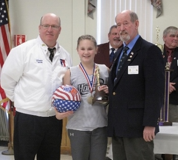 Peyton Grant of Newport won the Maine State Hoop Shoot championship in the girls' age 12-13 division on Jan. 25, 2015 at the Augusta Elks Lodge. She now advances to the New England Regional round at Deering High School in Portland on March 28. Pictured, from left, are Maine North Hoop Shoot Chairman Shawn Stacey, Peyton and State President Tom Callahan.
