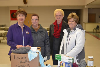 Pictured with one of the boxes are (from left) Washington Lodge Food and Toy Project Coordinator Barbara Delleart, Pregnancy Assistance Center representative Fritzi Alfermann, Loving Hearts Outreach representative Sandy Crider, and St. Vincent de Paul Society representative Nancy Eckelkamp.